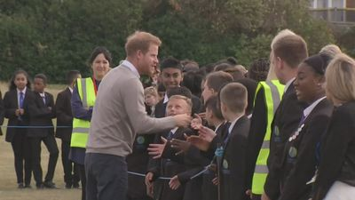 Prince Harry high fives school kids in Luton
