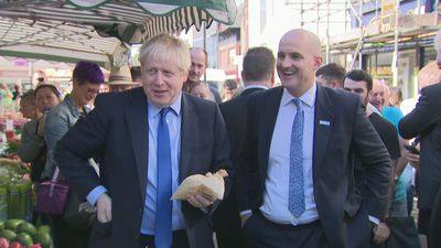 Boris Johnson buys a pound of plums at Doncaster Market
