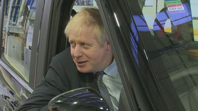PM poses in black cab during election campaign visit
