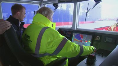 Boris Johnson drives dredger on Bristol port visit