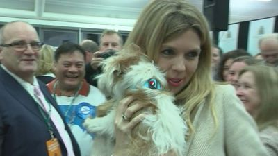 Carrie Symonds arrives with dog Dilyn
