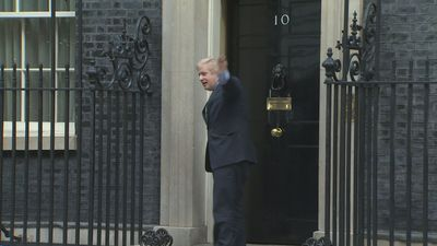 Boris arrives at Downing St after meeting with the Queen