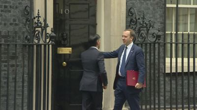 Hancock hugs colleague Sunak outside 10 Downing Street