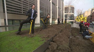 Extinction Rebellion dig up lawn outside Home Office