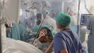 Patient plays violin as surgeons perform brain surgery
