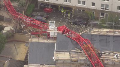 Crane crashes into homes in east London