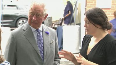 Prince Charles and Camilla meet workers at shirt factory