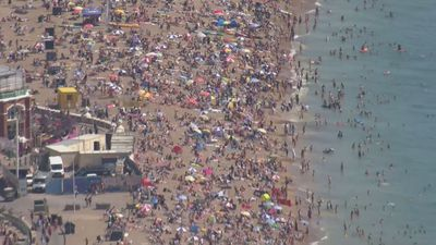 Sun seekers flock to Camber Sands and Brighton Beach