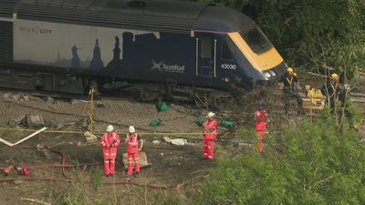 Police and Network Rail at scene of derailment