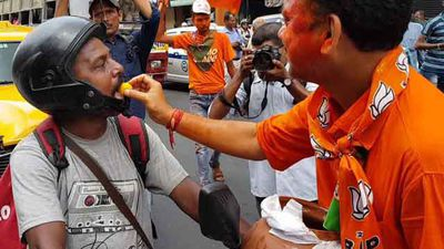 BJP Supporters In West Bengal Celebrate With Saffron Rosogollas