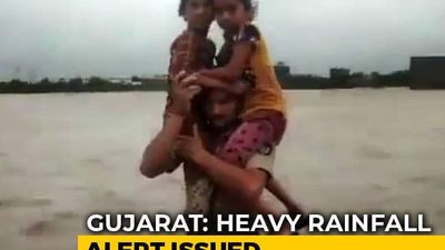 Gujarat Cop Carries 2 Girls Through Waist-Deep Floodwater, Wins Praise