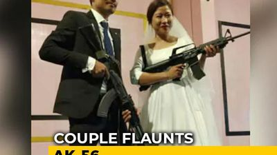 Naga Rebel's Son, Bride Flaunt Assault Rifles At Wedding Reception