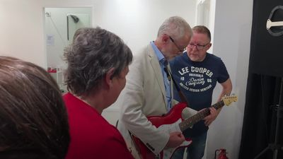 Jeremy Corbyn plays guitar during Bolton visit