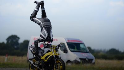 British daredevil performs a handstand on a motorbike at 76mph in record attempt