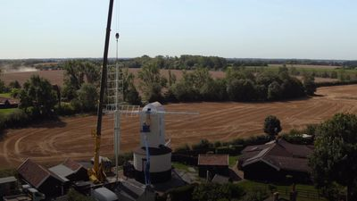 Historic windmill is fitted with new sails