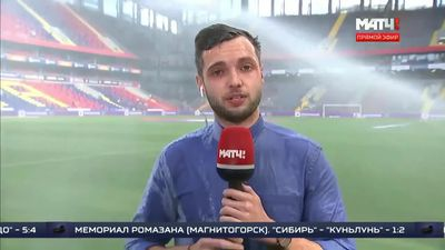 Russian TV presenter gets showered by sprinkler
