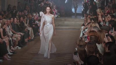 Julien Macdonald presents glittering collection at London Fashion Week