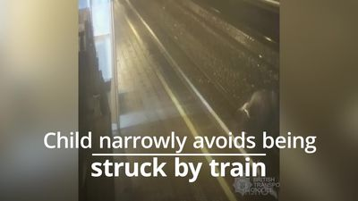 Boy narrowly avoids being hit by train