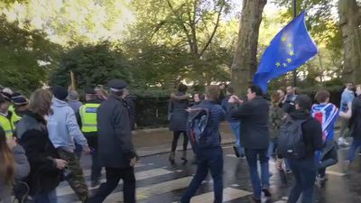 Jacob Rees-Mogg and his young son heckled by Brexit protesters