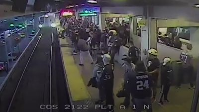 Watch as passenger pulled out of train's path with seconds to spare