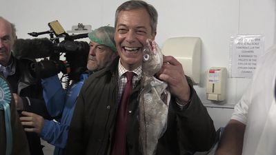 Farage poses with fish during Grimsby election campaign stop