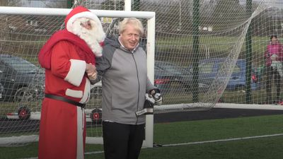 Boris Johnson plays in goal and meets Santa