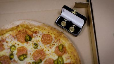 Gold pizza cufflinks aim to take a slice of leap day romance