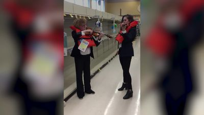 Violinists serenade empty toilet roll aisle in Los Angeles store