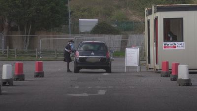 NHS staff conduct Covid-19 tests at Chessington drive-through centre