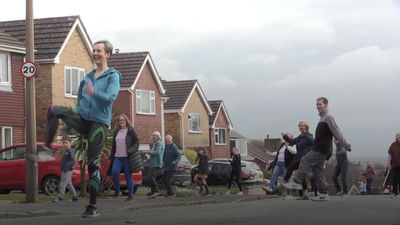 Street comes together for socially distanced dancing