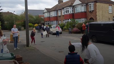 Neighbours rally round to sing happy birthday to seven-year-old boy