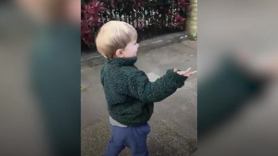 Three-year-old waves hello to everyone he meets