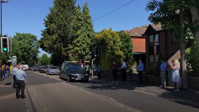 Colleagues line street for funeral procession of NHS worker