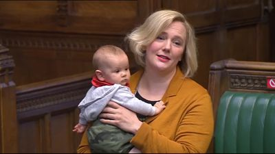 MP contributes to abortion debate holding her baby daughter