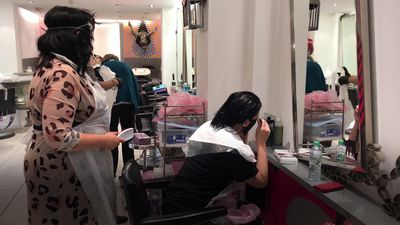 Hairdressers offer midnight cuts as coronavirus restrictions lifted