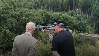 Charles commends first responders for bravery on train crash site visit