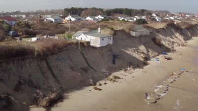 Section of Norfolk clifftop home falls on to beach