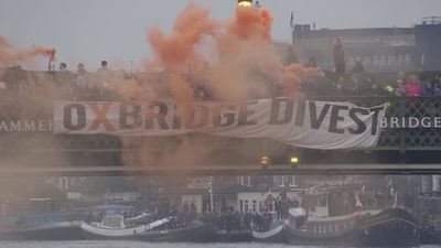 Protesters perform stunt during Oxford-Cambridge boat race