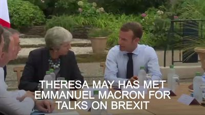 May meets Macron in bid to win support for Brexit plans
