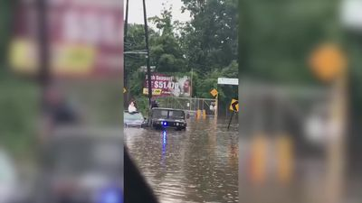 Police help bride escape floodwaters on her wedding day