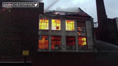 Firefighters tackle blaze at mill in Manchester