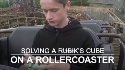 Teen solves Rubik's Cube on rollercoaster