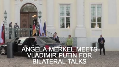 Angela Merkel and Vladimir Putin meet for bilateral talks