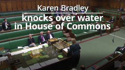 Labour MP crosses the floor to help Cabinet minister with spilt water