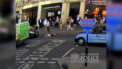 Man shoved into busy road at rush hour