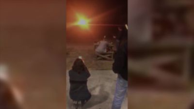 Woman blows up wedding dress during divorce party