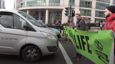 Climate change protesters block roads in central London