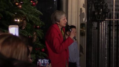 Theresa May in good spirits during Downing Street Christmas lights switch-on