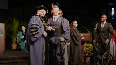 Quadriplegic student walks across stage for graduation ceremony