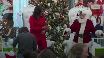 Michelle Obama dances with Santa Claus during hospital visit